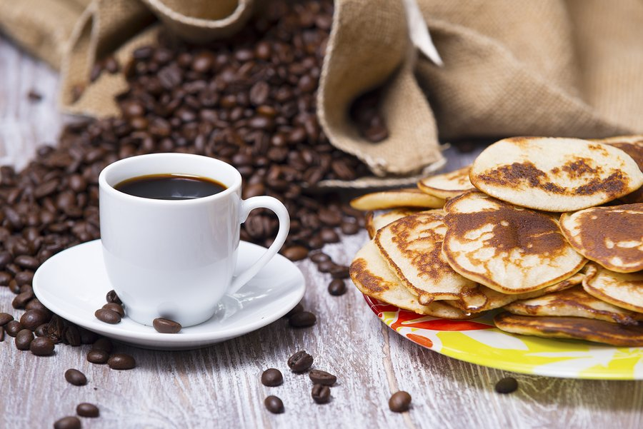 cup of coffee and pancakes on the table
