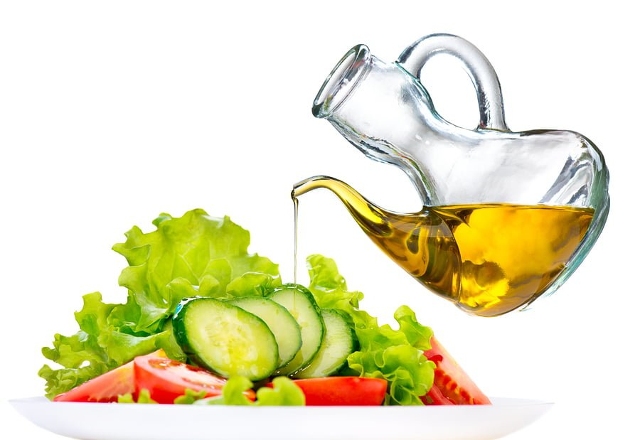 Healthy Vegetable Salad with Olive oil dressing isolated on whit